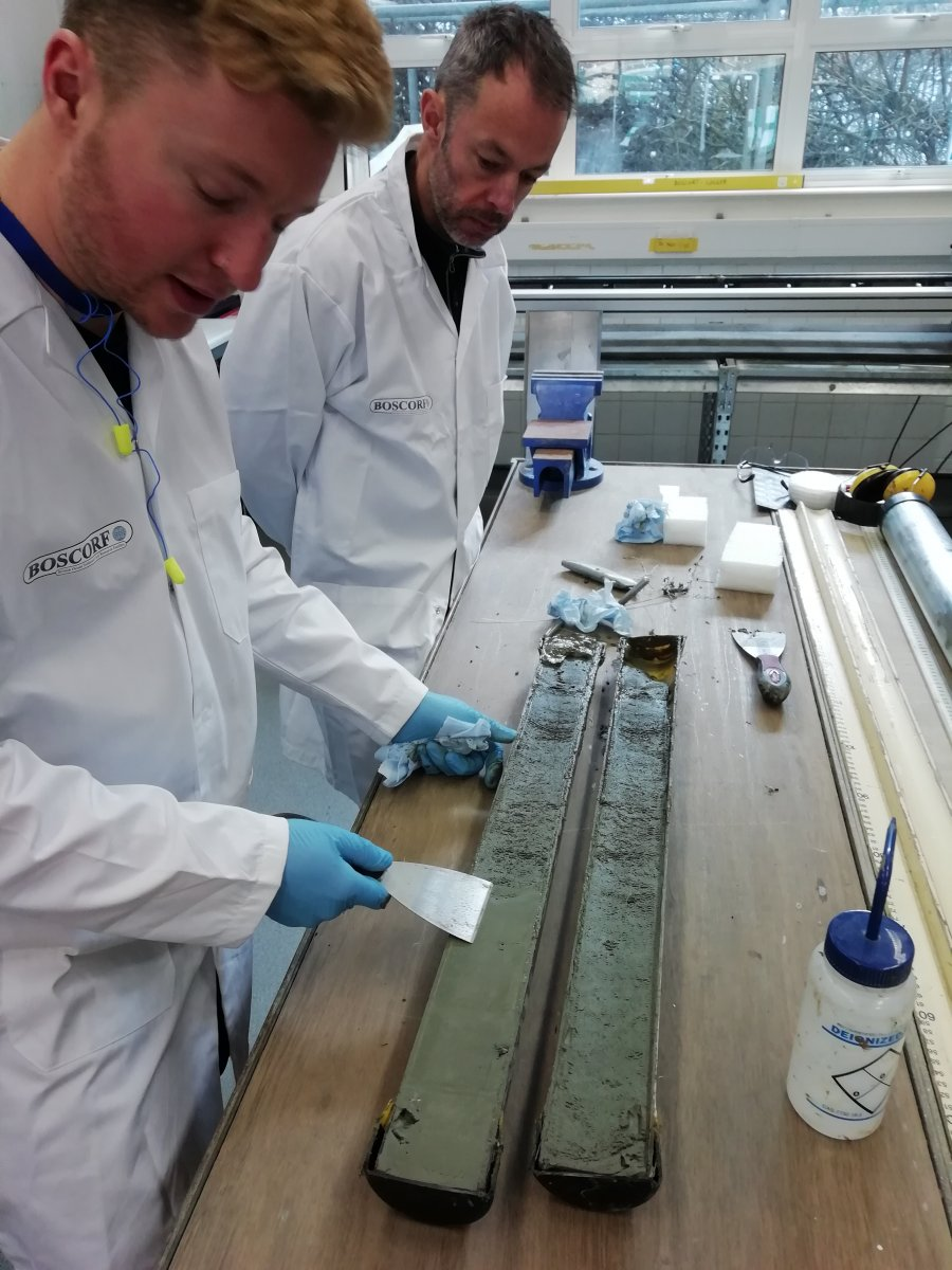 Image 3: Tom Bradwell (University of Stirling) and Mike Edwards (BOSCORF) assessing the condition of a recently split sediment core in the BOSCORF Laboratory (image courtesy of Allan Audsley)